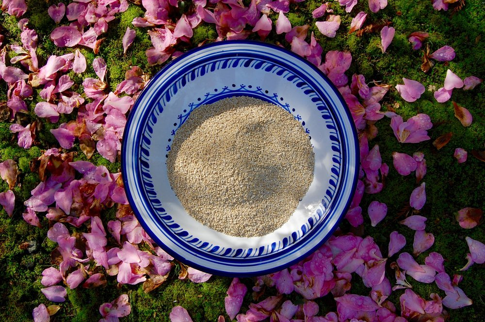 A bowl of dry, steel-cut oats.