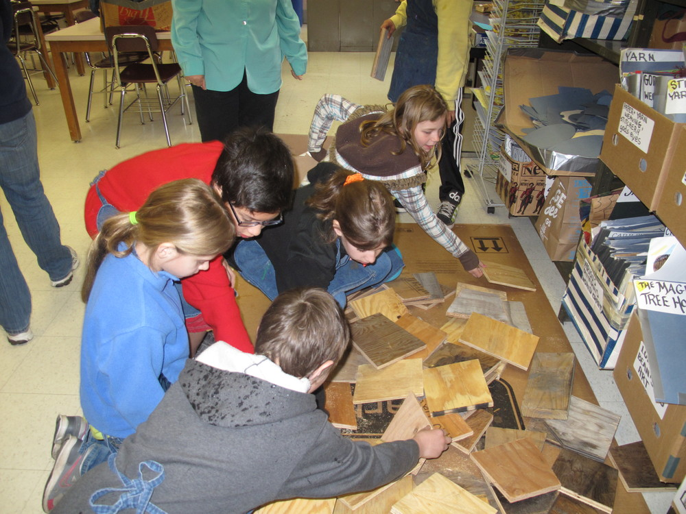 Elementary school students picking out their wood backing