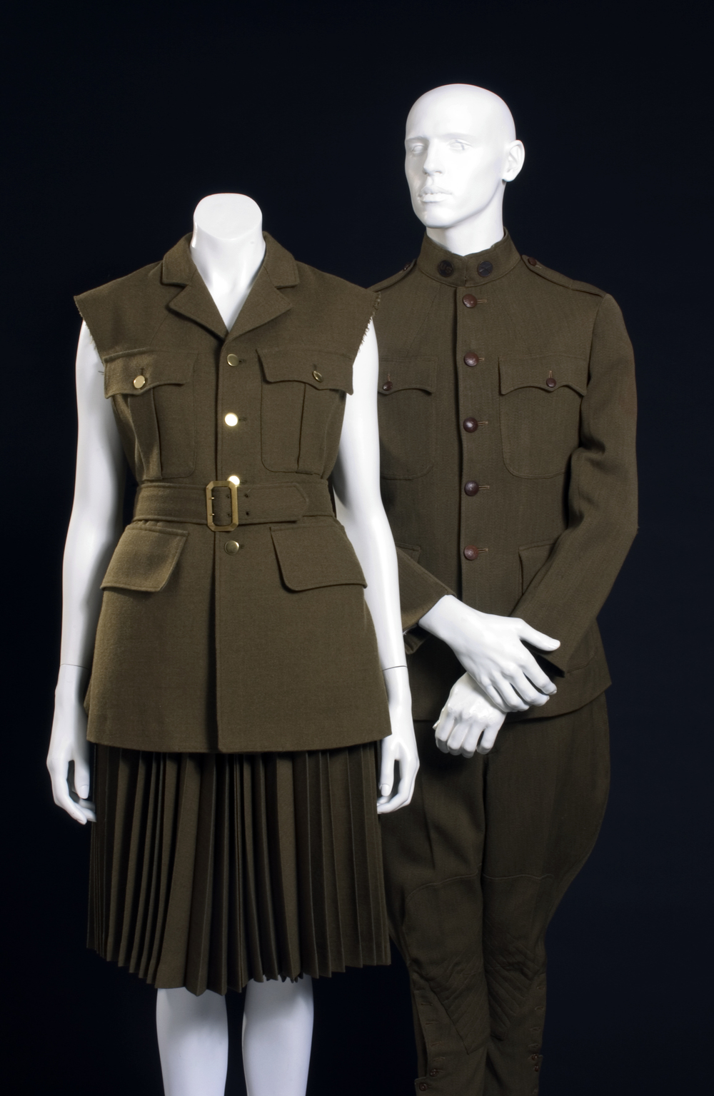 (left) Comme des Garcons (Rei Kawakubo), ensemble, 1998, wool, Japan, museum purchase; (right) U.S. Army World War I Service Uniform, 1914-1918, wool, USA, Gift of Mrs. Roswell Gilpatric. Photo courtesy of Museum at FIT.
