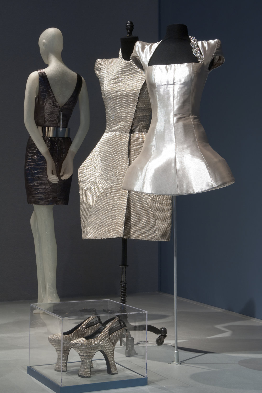 "Dresses and shoes from the ARMOR section of the exhibition ""Daphne Guinness"" at The Museum at FIT. Photograph courtesy The Museum at FIT"