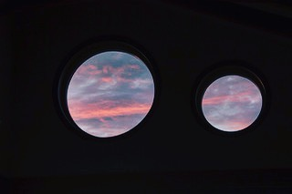 Late summer skies showcased through Highwater House's round window lights....setting the tone for another special night on Haida Gwaii. #beautiful #sunsetbeach #haidagwaiibeauty #lovewhereyoulive