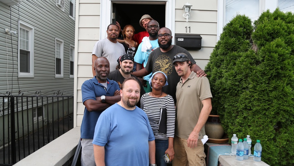 "From the top (clockwise): Charles ""CJ"" Jones (DP), Rich Smith (Key PA), LeRon Lee (Director), Brian Pengitore (1st AD), Stacy Gardner (Script Supervisor), Johnathon Proctor (1st AC), Derrick Williams (Producer), Adam Chinoy (Grip), Simeon Moore (Gaffer), Cytia Fontenette (2nd AC)"