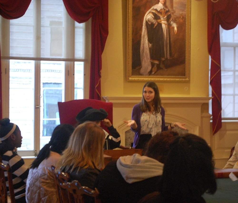 Education Associate Jennifer Guerin giving a tour on the Boston Massacre inside the Council Chamber of the Old State House.