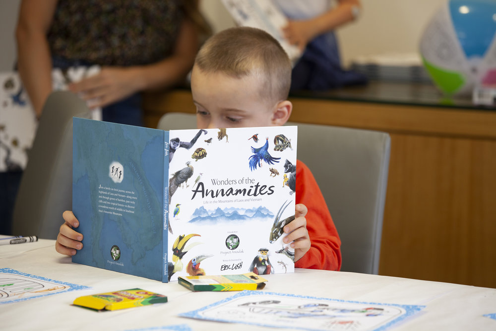 "Young reader enjoying ""Wonders of the Annamites"" at Hunter Public Relations in New York City"