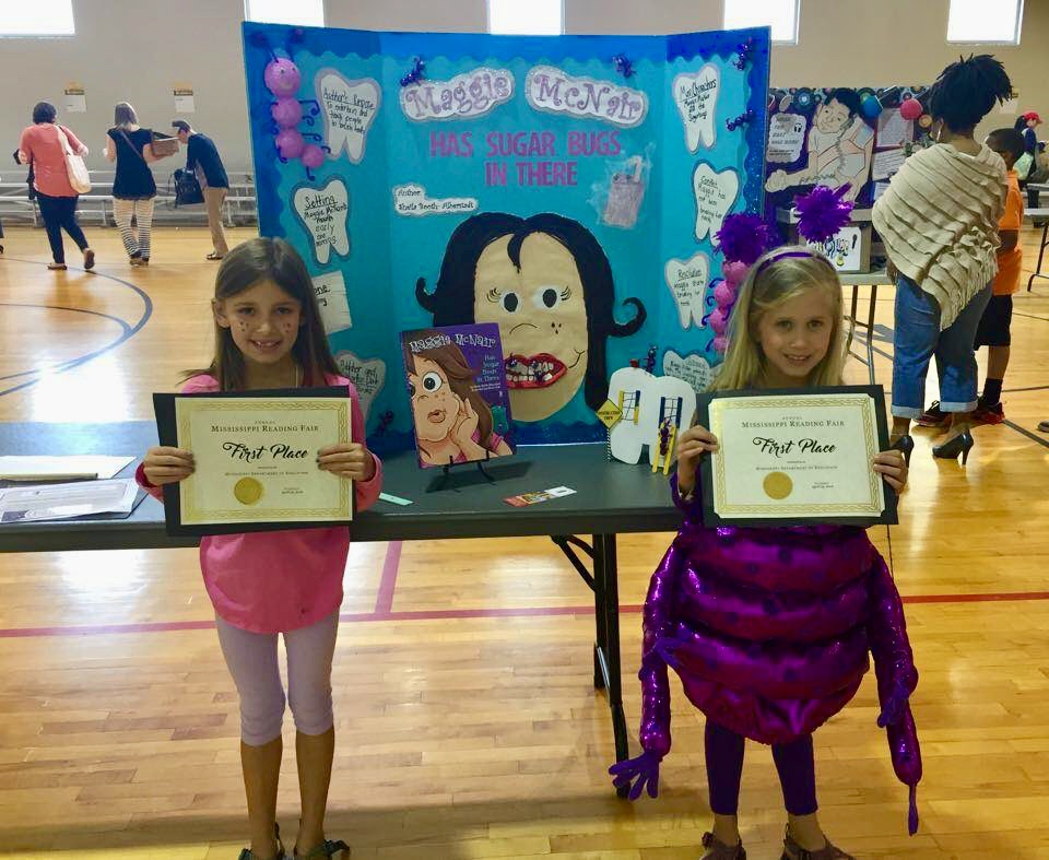 Mary and Millie won 1st place at the Mississippi state level reading fair.