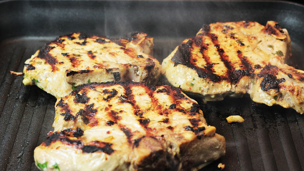 Pan-charred pork chops dark