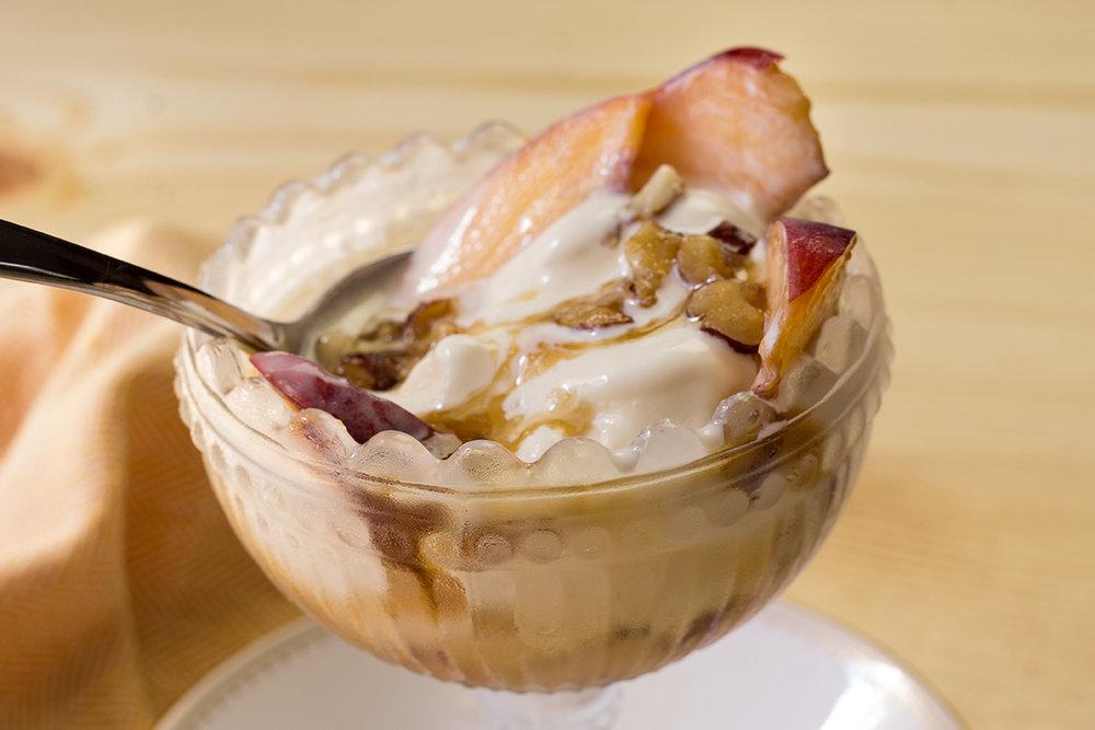 Hazelnut topping on Vanilla Ice Cream and Peaches