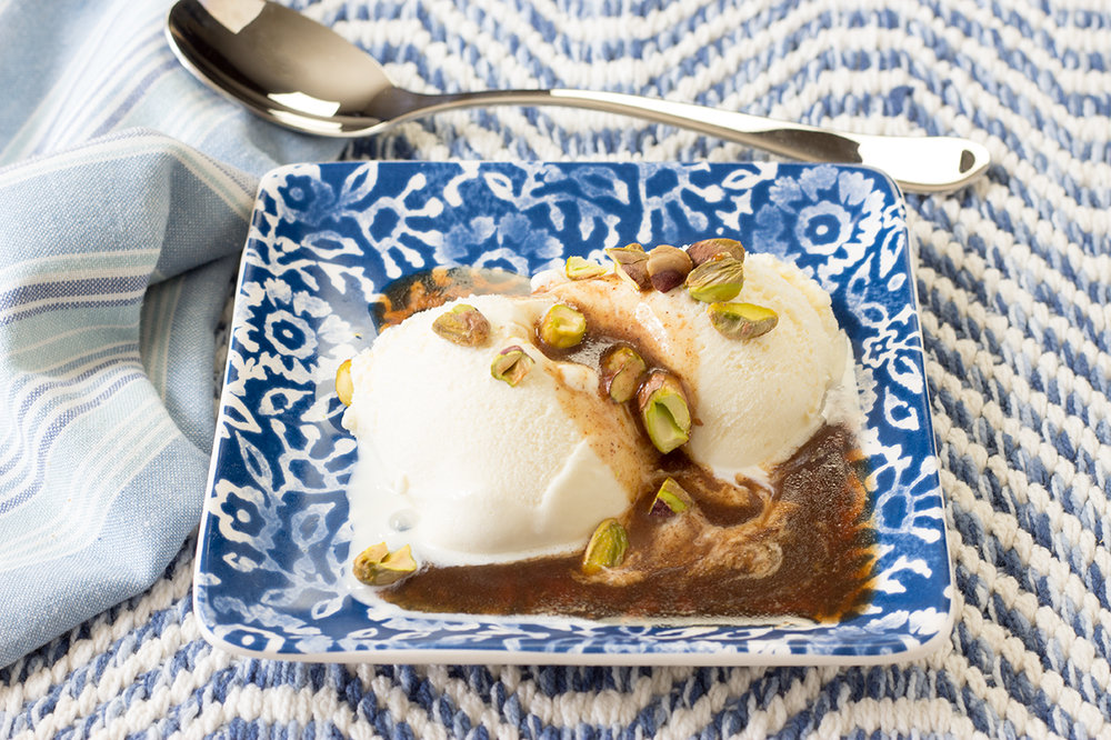 Butter Rum Sauce and Chopped Pistachios over Vanilla Ice Cream