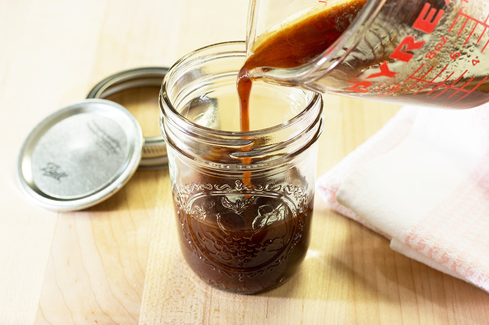 Pouring Butter Rum Sauce in Preserve Jar