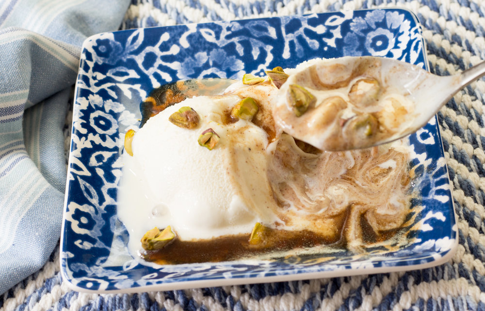 Enjoying Butter Rum Sauce and Chopped Pistachios over Vanilla Ice Cream