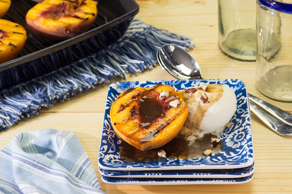 Pan grilled peaches with ice cream and butter rum sauce