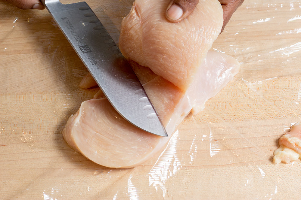 Starting at the thick end of the breast, slice it length-wise.