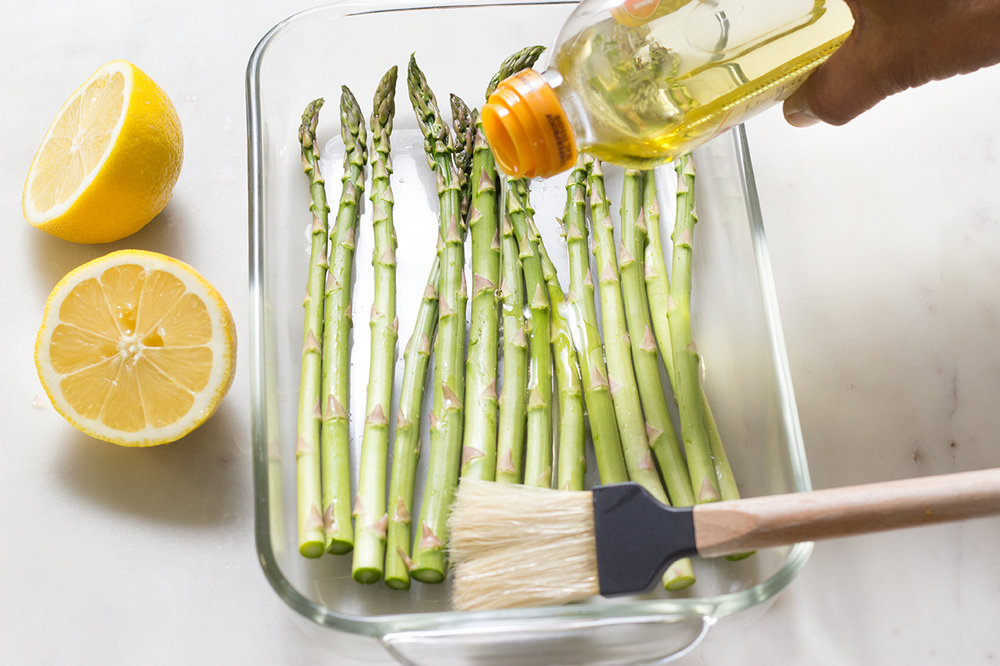 Brush olive oil on asparagus, season with salt & pepper.