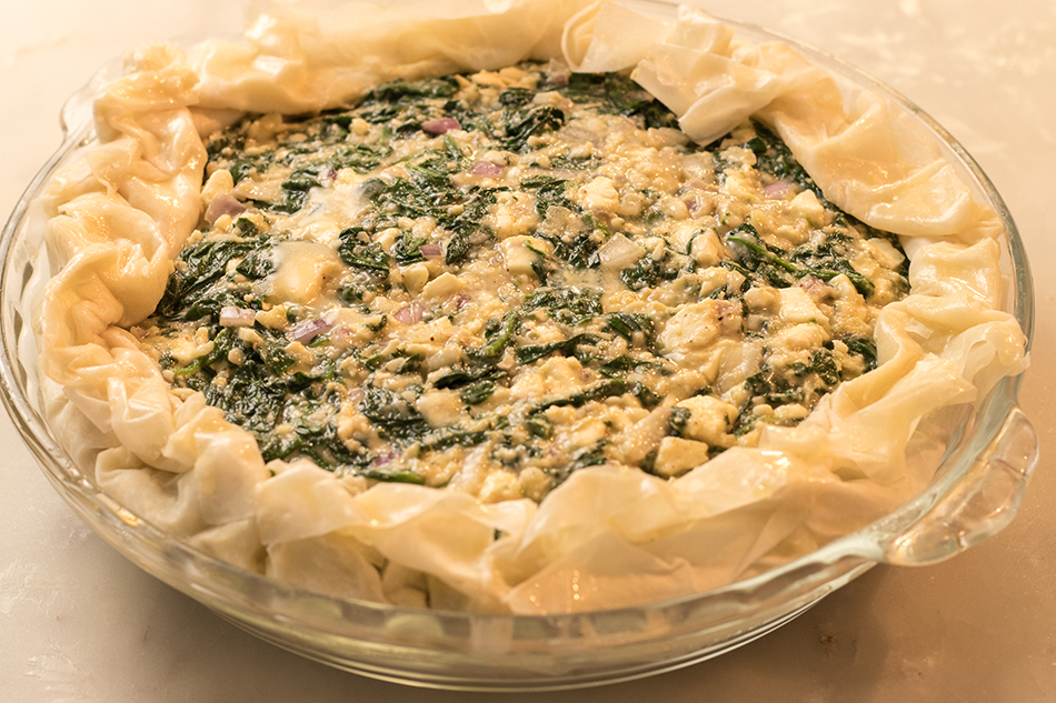 Gently pick up dough, place in a pie dish, add filling and fold ends of dough over the edge of the pie.