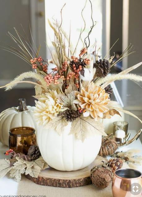 White floral pumpkin fall centerpiece   source