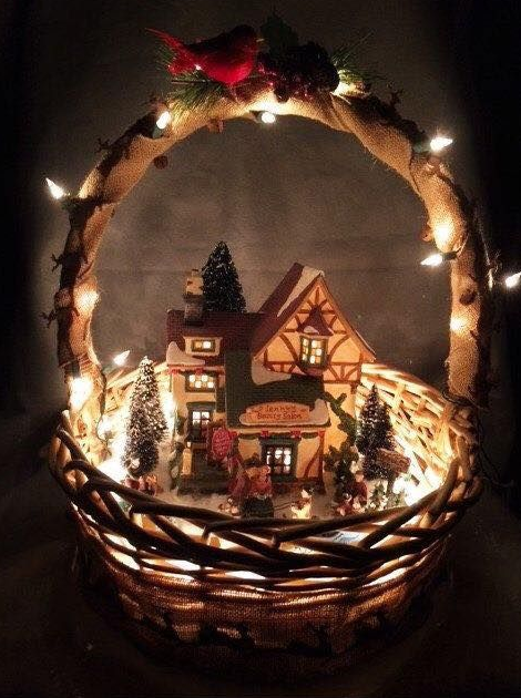 Christmas village with lights in a basket   image source