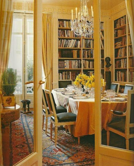 Classic dining space is also a library   source