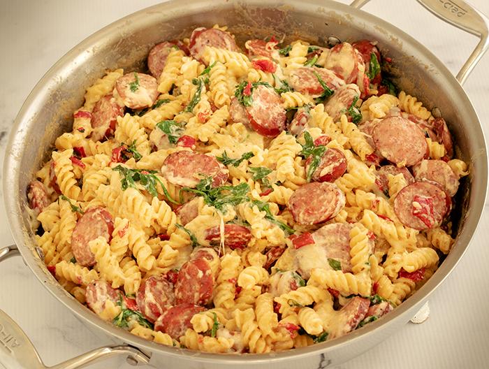 kiolbassa sausage and pasta in cooking pan