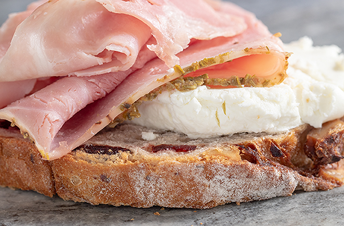 Rosemary Garlic Ham and Goat Cheese on Cranberry Walnut Round Bread