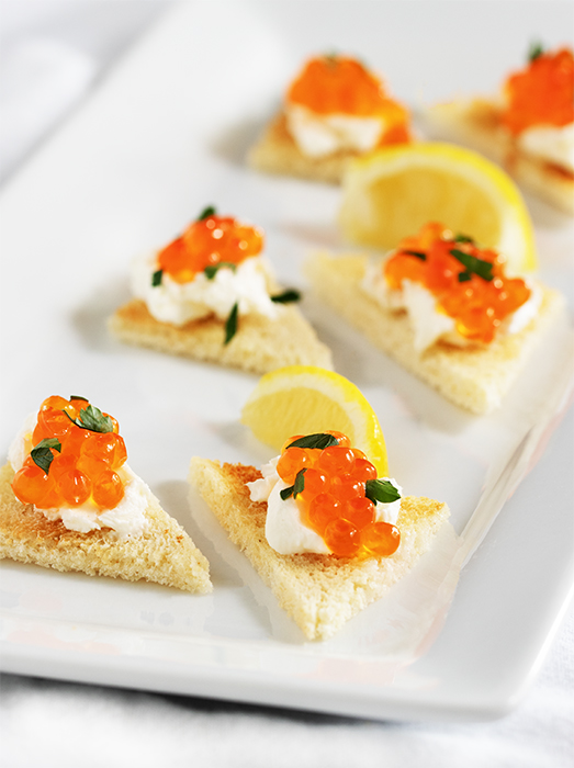 Wild salmon eggs and cream cheese appetizer