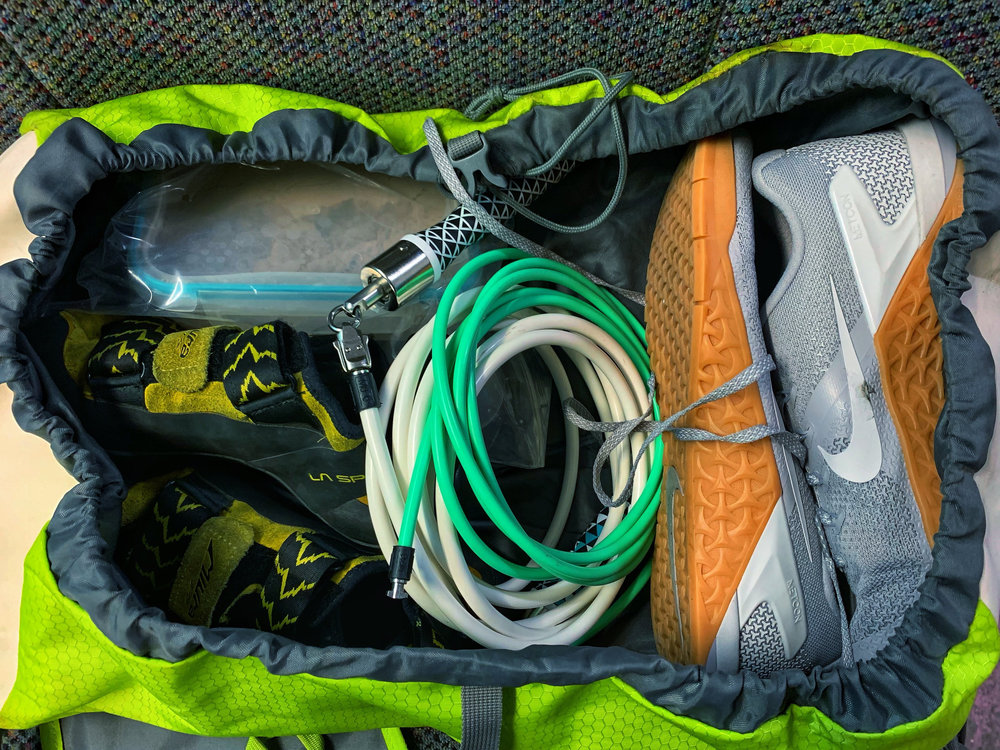 The gear bag packed with essentials for training at Evolution Healthcare and Fitness.