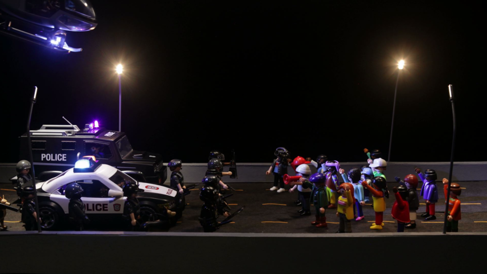 THE HIGHWAY     The Highway  is a short animated film that recreates a highway protest against police violence in miniature toy scale, along with scenes from historic, cultural, and mythological antecedents in American and Western culture.