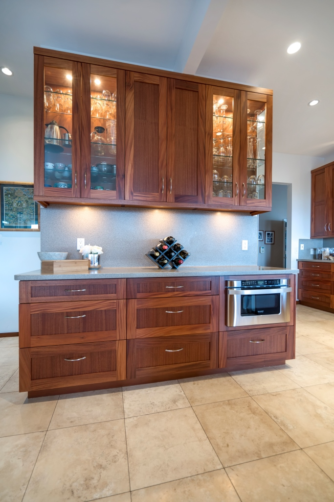 SAPELE BAR CABINETRY WITH GLASS DOORS AND RECESSED LIGHTING