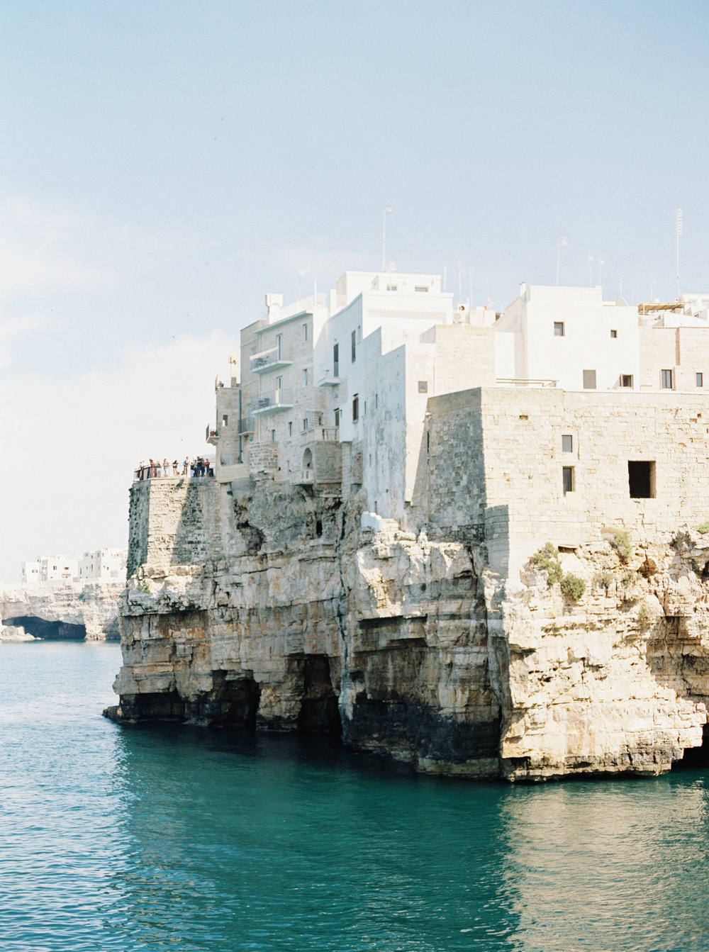 Polignano a Mare - southern Italian wedding planned by Meggie Francisco Events. Photography by Tracy Enoch, video by Innar Hunt, floral by Chiara Sperti.