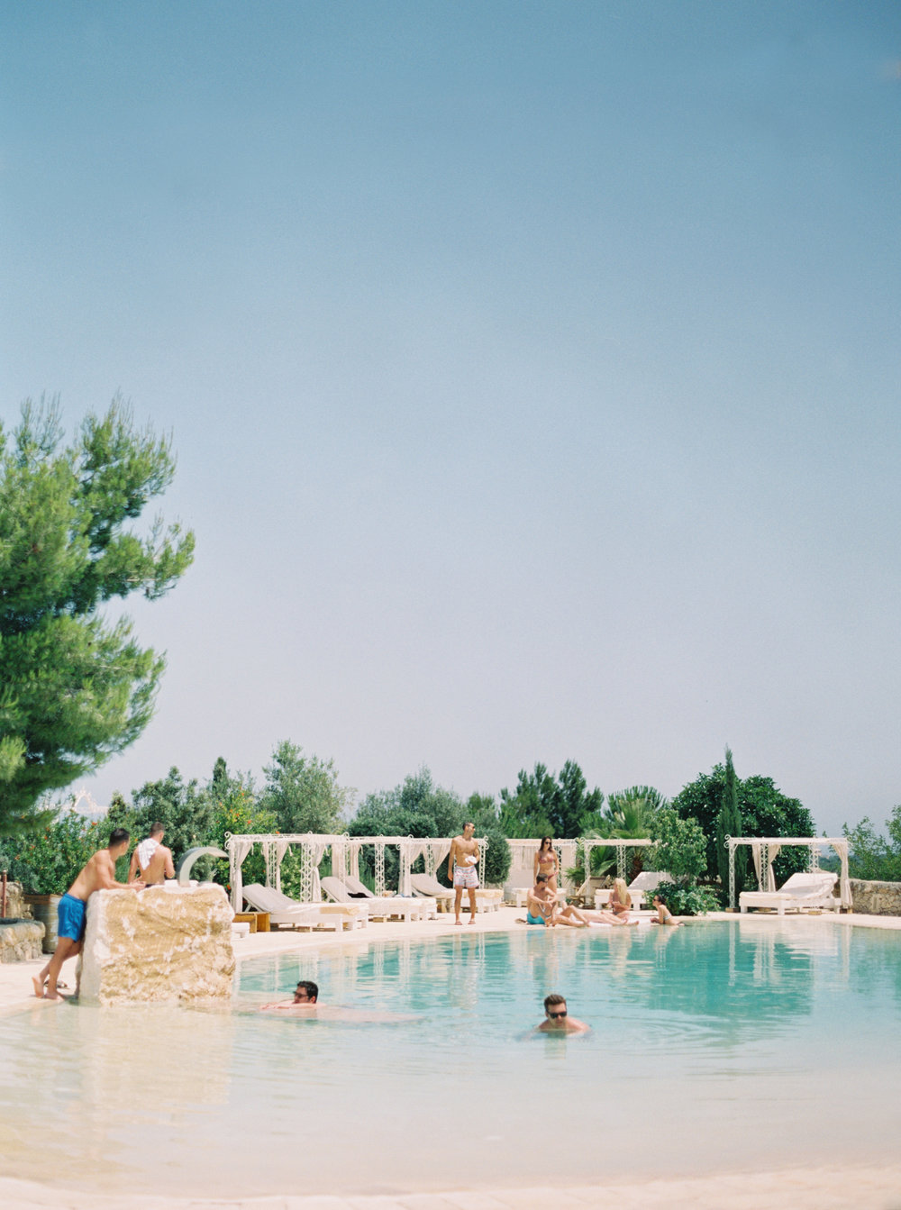 Masseria Montenapoleone - Post wedding pool party planned by Meggie Francisco. Photography by Tracy Enoch. Location: Masseria Montenapolone.