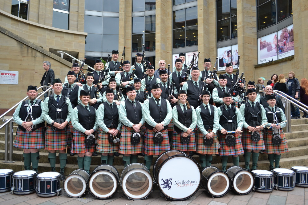 The band standing on the steps of the Glasgow Royal Conservatory in Glasgow, Scotland during the 2015 World Pipe Band Championship trip.