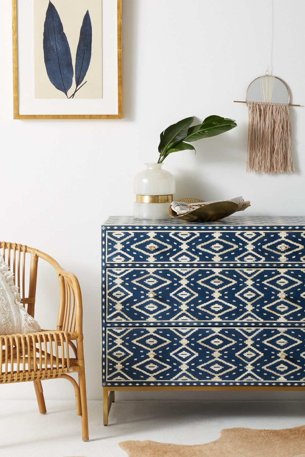 Bring a little bit of Morocco in your home. - This cool, coastal, moroccan style dresser is definitely understated and set perfectly with the white walls and warm wood chair and picture frame. Navy, white and warm wood pairs so perfectly together!Photo and dresser by: Anthropologie