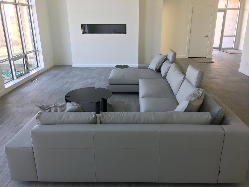Ligne Roset 'Exclusif' sectional and B&B Italia tables