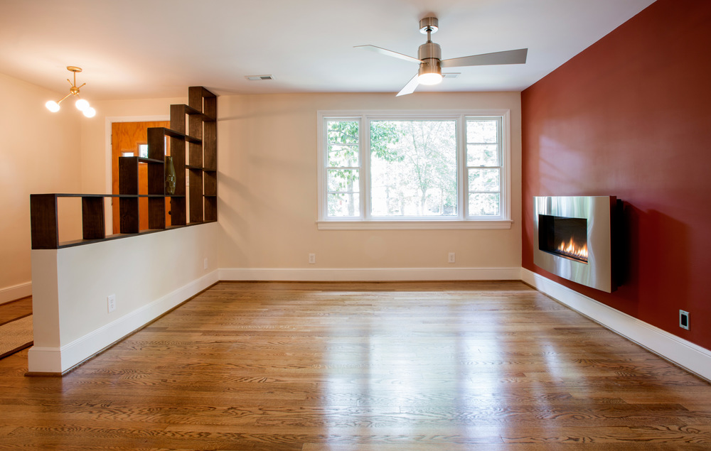 Custom wall divider and new fireplace in Living Room. (Photo: Kent Eanes)