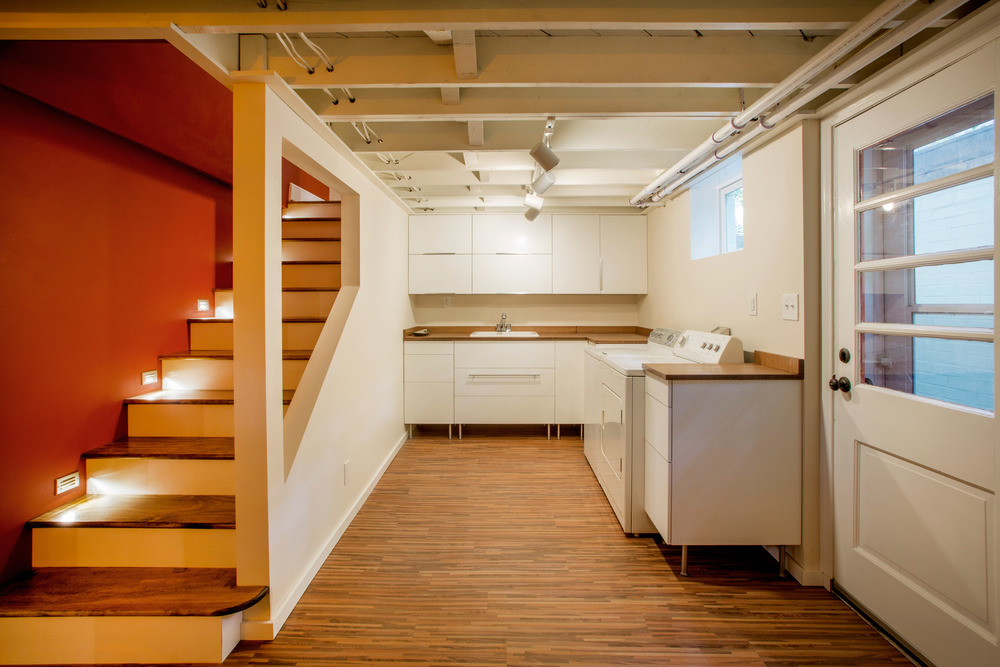 Laundry Room and stair lights in Renovated Basement. (Photo: Kent Eanes)