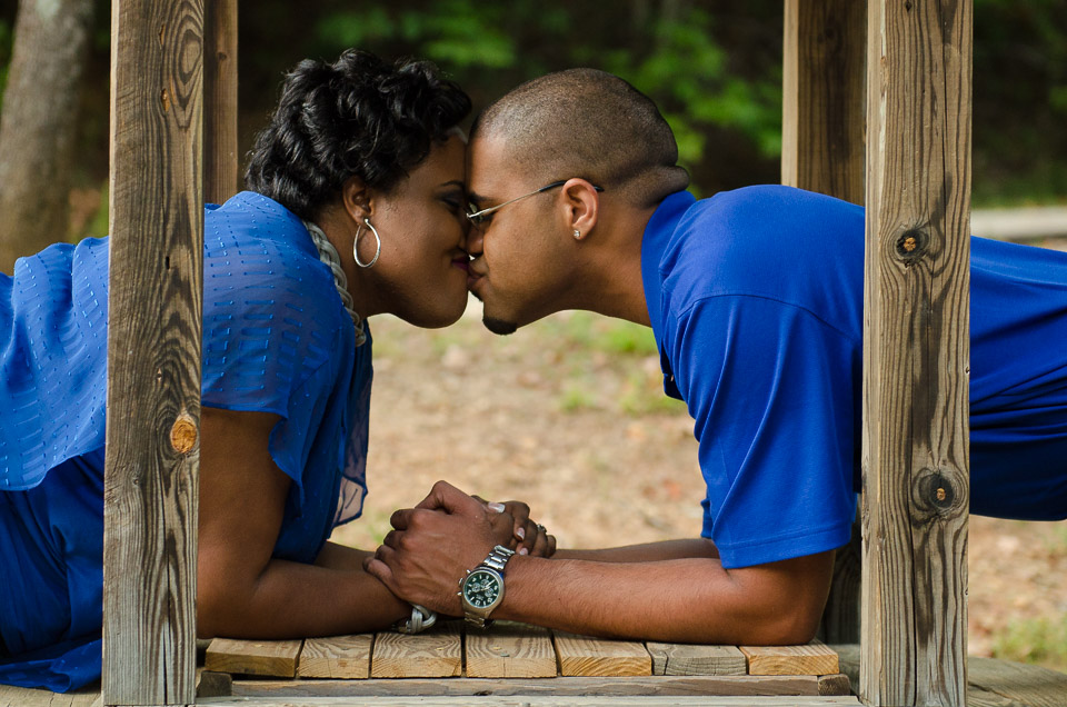 Engaged couple kissing over well at Campbell's Covered Bridge