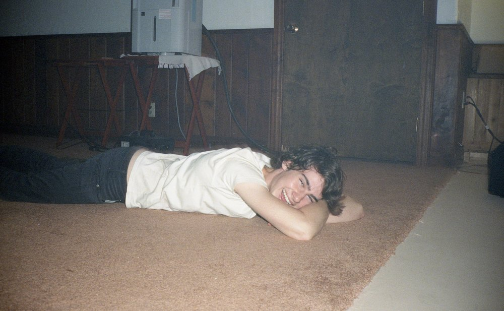Jimmy, high, laying on the floor, 2016