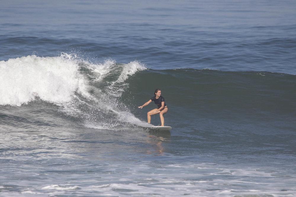 Surfing at Batu Bolong in Canggu, Bali