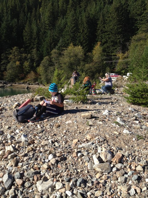 Students learning about water cycles on the beach of Diablo Lake.