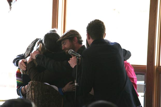 C14 embracing Joshua Porter during the Graduation Ceremony.