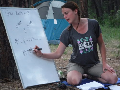 Emily Baronich showing how interconnected math and the natural world is through the Fibonacci sequence.