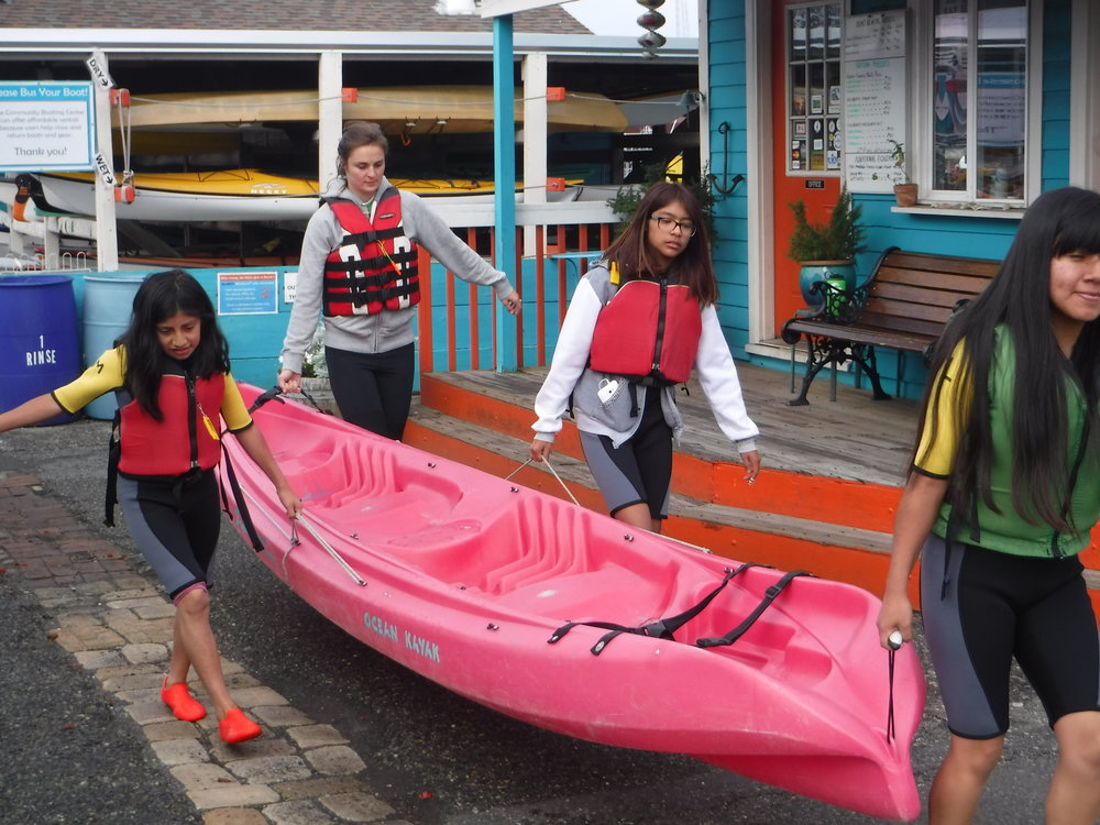 Carrying our kayaks to shore