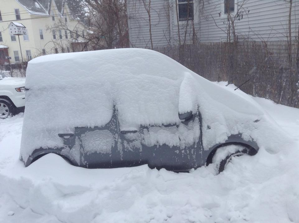 Snow piling up on my car in Manchester, NH