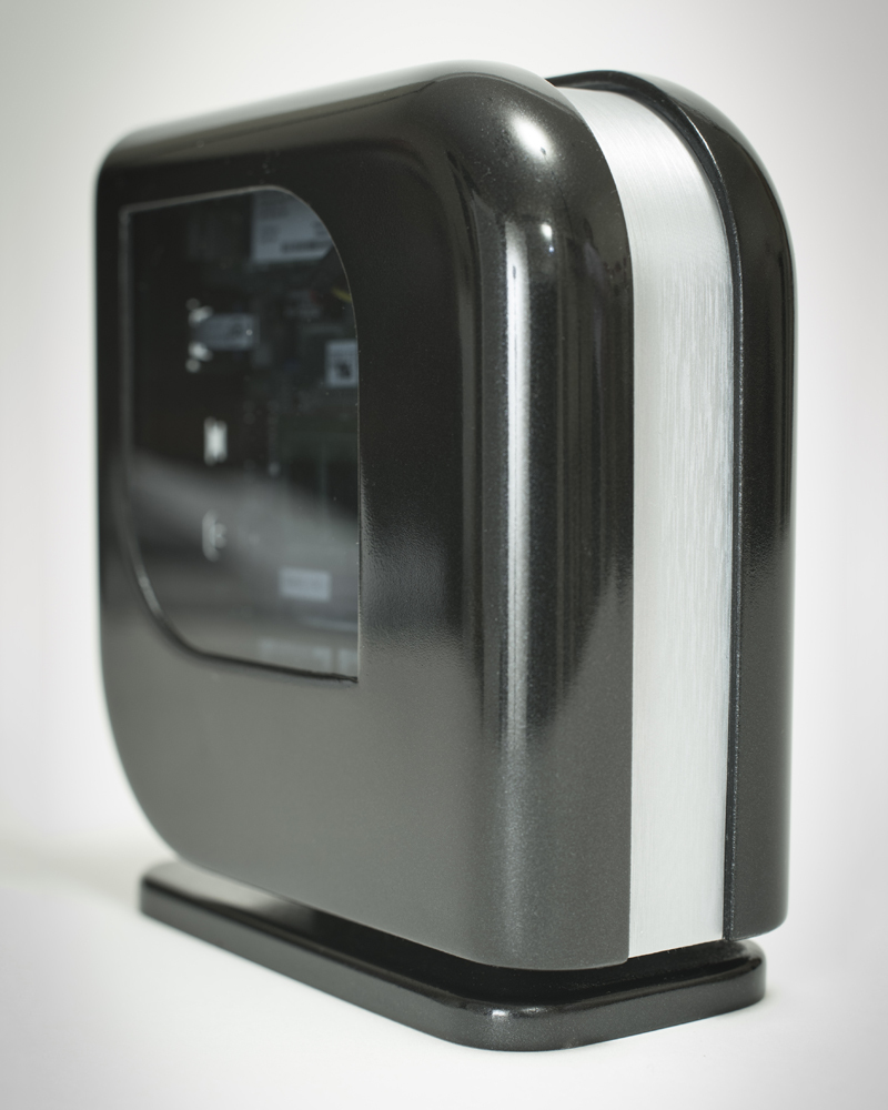 MODERNE, 2015       Moderne is a case designed for the 2014/15 Intel/Bit-Tech NUC competition.  It was one of the 5 final designs picked to be turned into reality.    The whole case is 3D printed using SLS Nylon, with smoked acrylic windows that act as status lights, letting you know whether the system is on or not.  Inspired by the modernist streamliner trains and cars of the 1930s, I tried to make sure there were no external buttons or distractions.  Instead, the front is touch sensitive, so you control the system with the swipe of a finger.