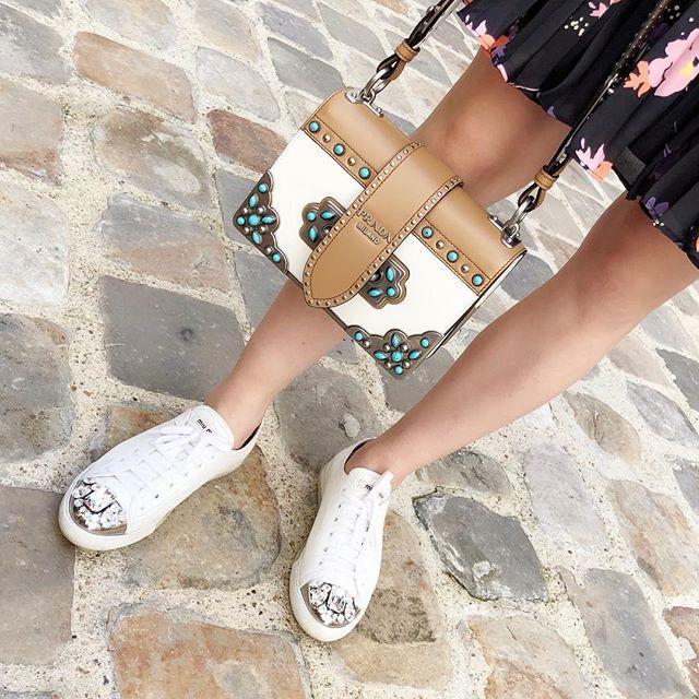 In best holiday company with Prada Cahier studded shoulder bag and Miu Miu jewelled sneakers 💎💎 #ninashelsinki #prada #miumiu