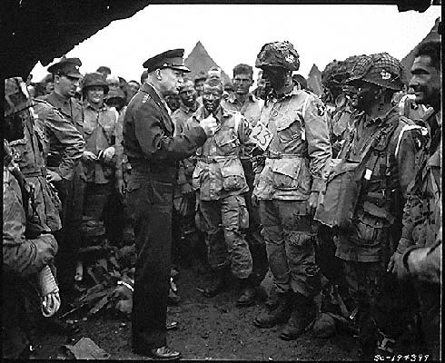 Photo by  The U.S. Army : Supreme Allied Commander U.S. Army Gen. Dwight D. Eisenhower speaks with 101st Airborne Division paratroopers before they board airplanes and gliders to take part in a parachute assault into Normandy as part of the Allied Invasion of Europe, D-Day, June 6, 1944.  www.army.mil/d-day