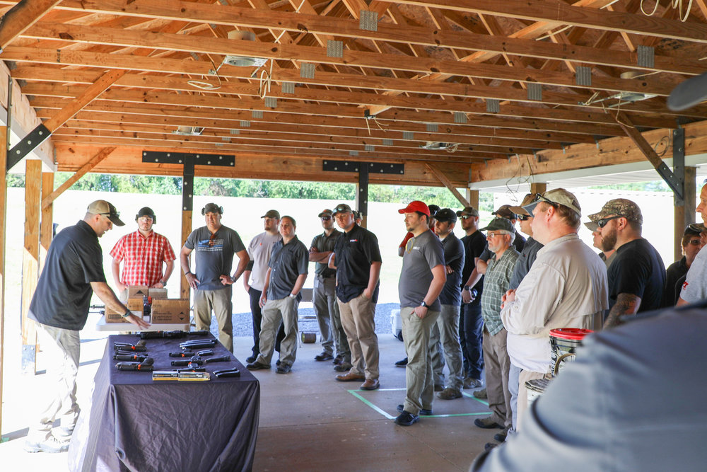 Scott Berube from SigSauer goes over safety precautions during TSSi's range day