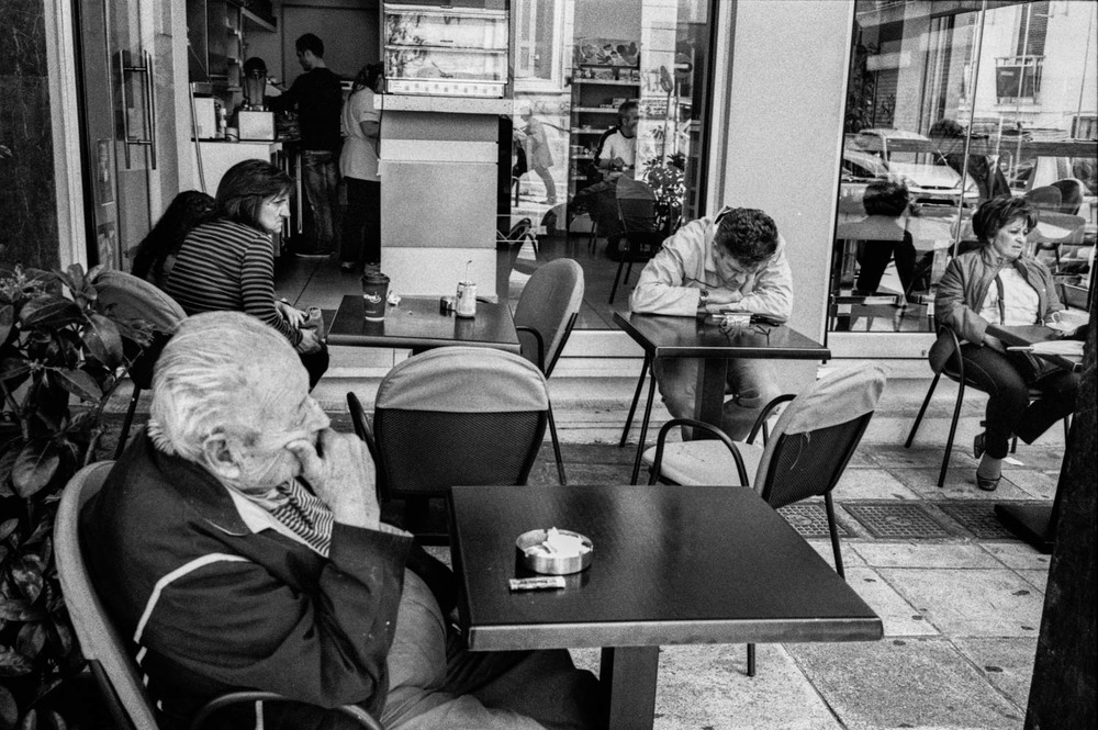 customers of a coffe shop in central Athens look gloomy in the midst of the current economical crisi that has heavily affected the most of Greek population.