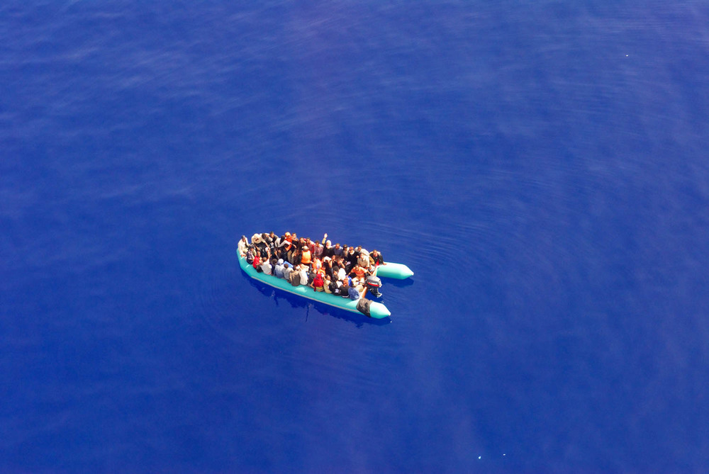 Sicily - Illegal Immigration - View of a small immigrant vessel