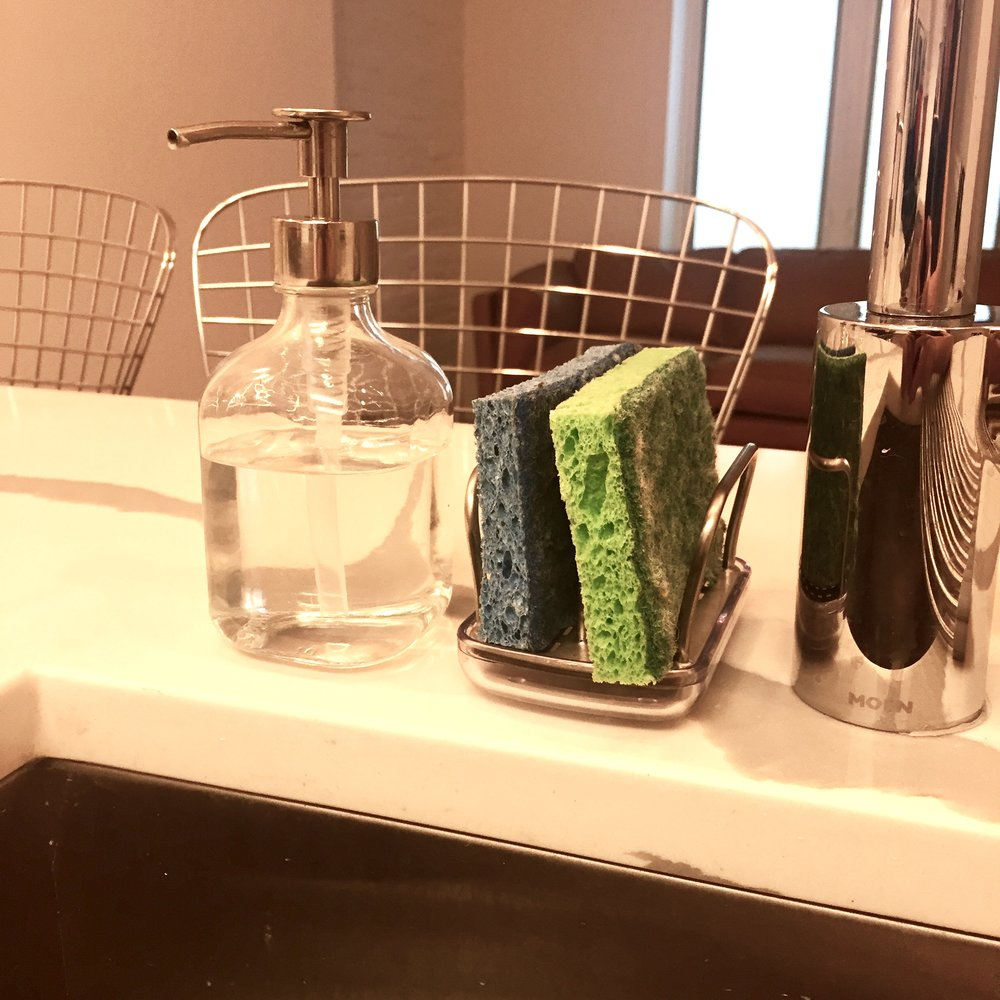 Soap Dispenser + Sponge Holder - I hate the way a plastic soap detergent bottle looks on my kitchen counter. So I got this super clean and simple one for $8 from IKEA and the problem is solved! With the OXO sponge holder by its side, I'd say this couple can't be beat.