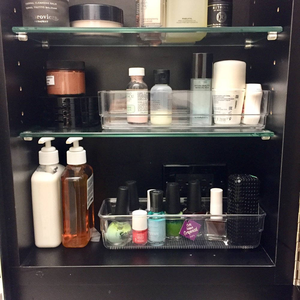 Keep like-items contained - Small, loose items (like little bottles and creams) love toppling out of medicine cabinets so stop them before they can misbehave. Contain categories of products in clear containers so you can see what's what and avoid The Dreaded Topple.